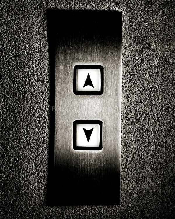 Elevator buttons for moving a level up or one down